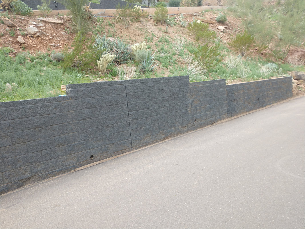 This is a picture of a standard gray concrete block wall in San Diego.