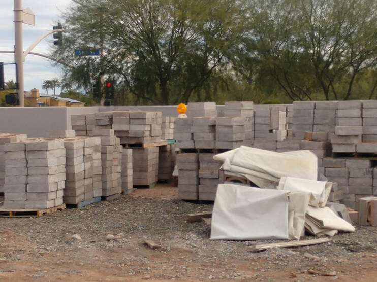 A picture of cinder block in piles ready to be made into a wall in San Diego.